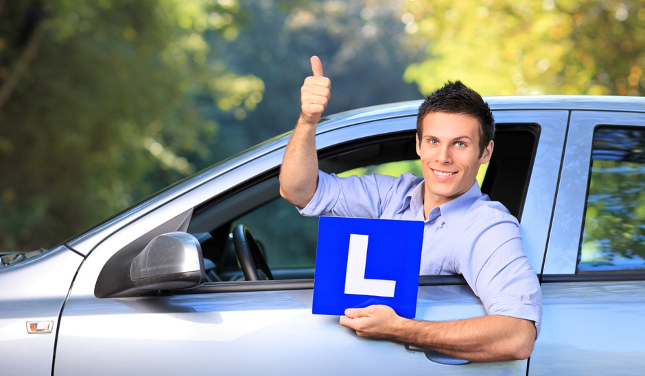 Happy male holding a L sign and giving thumb up